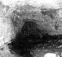 Bell Witch Cave mouth with gate