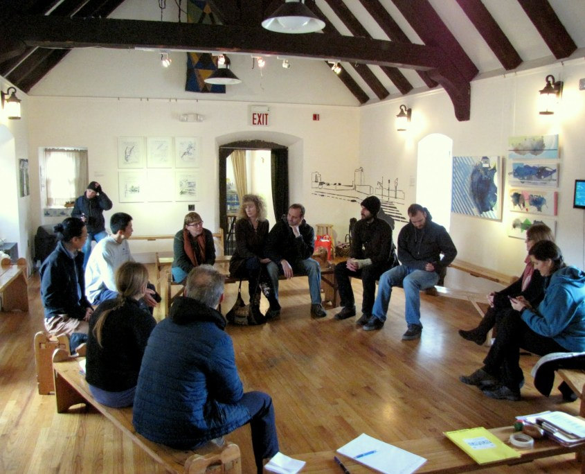 Discussion amidst artwork on display at OSH