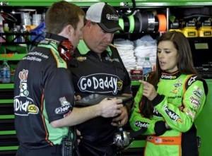 Danica talks to her crew members during race practice