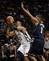 Penn State's Brandon Taylor looks for a shot past Michigan's Glenn Robinson III