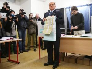 Silvio Berlusconi shows off his ballot