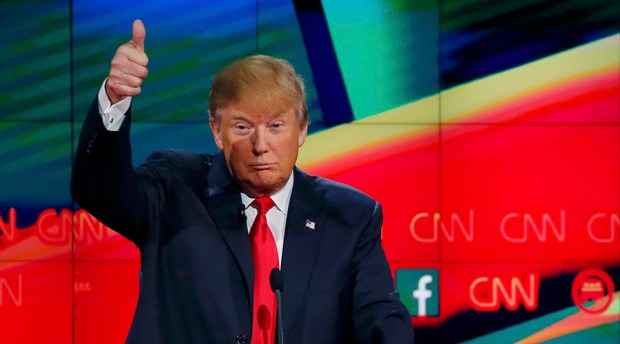 Republican U.S. presidential candidate businessman Donald Trump gives a thumbs up as rival candidate Senator Ted Cruz (not pictured) talks about building a border wall during the Republican presidential debate in Las Vegas, Nevada December 15, 2015.    REUTERS/Mike Blake