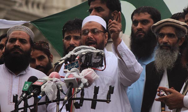 Hafiz Saeed, head of the Jamaat-ud-Dawa organisation and founder of Lashkar-e-Taiba, address an anti-India rally in Lahore August 14, 2013. REUTERS/Mani Rana (PAKISTAN - Tags: POLITICS CIVIL UNREST TPX IMAGES OF THE DAY)