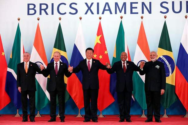 From left, Brazil's President Michel Temer, Russian President Vladimir Putin, Chinese President Xi Jinping, South Africa's President Jacob Zuma and Indian Prime Minister Narendra Modi pose for a group photo during the BRICS Summit at the Xiamen International Conference and Exhibition Center in Xiamen, southeastern China's Fujian Province, Monday, Sept. 4, 2017.  (Wu Hong/Pool Photo via AP)