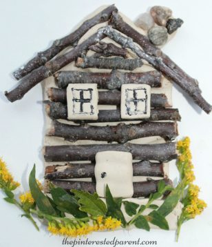 Clay and stick log cabin craft. Collect twigs and flowers to form your house. Salt dough will work as well. Kid's arts and crafts