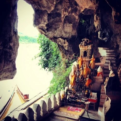 Most visitors take a boat ride up the river to the Pak Ou Caves to see all the Buddha statues.