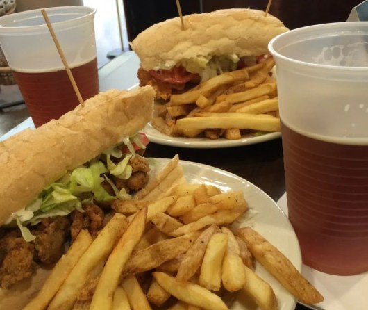 Shrimp and oyster po'boys (and local Abita beers) at MSY's Ye Olde College Inn