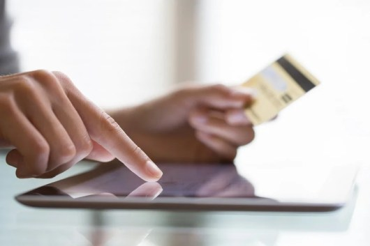 Make sure to use your own credit card to pay the taxes and fees on an award ticket, as they may ask you for it at the airport. Photo courtesy of Shutterstock.