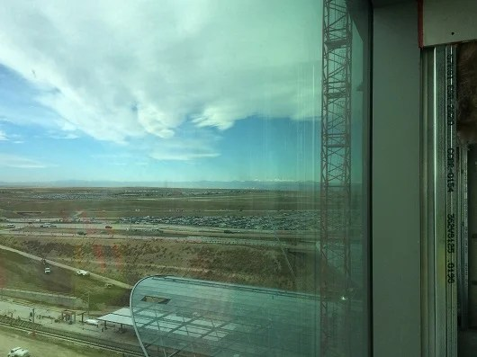 I visited a room under construction, with an amazing view of the train station with the Colorado Rocky Mountains in the background.