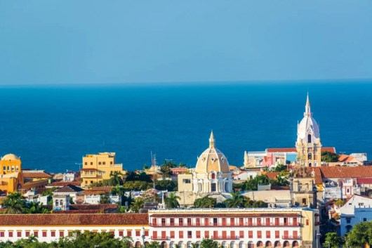 The historical churches and azul aguas of Cartagena, Colombia. Photo courtesy of Shutterstock.
