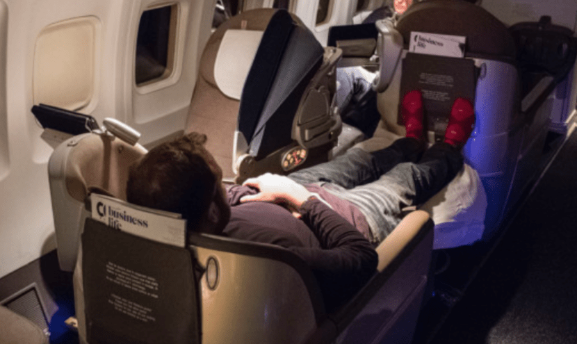This woman would have had to dive over my long gams (which also were clearly TOO long for the seat) in order to get out, so I recommend the back rows of each cabin.