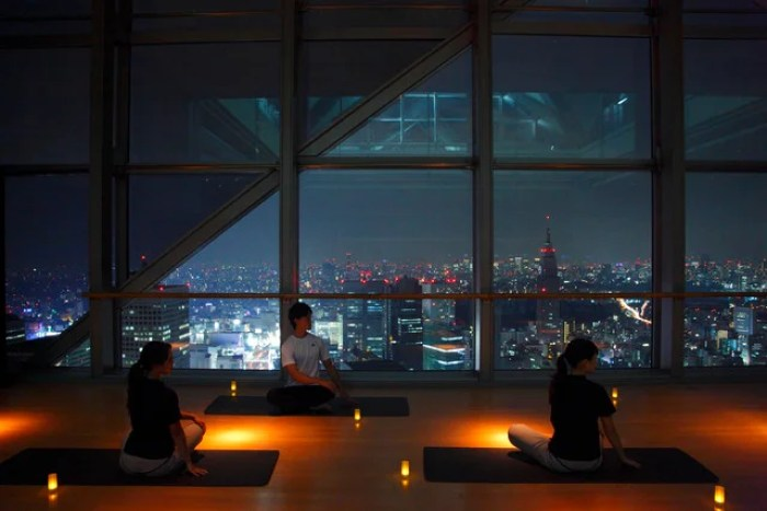 An evening yoga class, complete with relaxing views of Tokyo at the Park Hyatt Tokyo