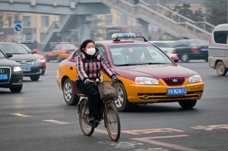 A local Beijing resident wears a mask to block out the city's obscene smog. Photo courtesy of Shutterstock.