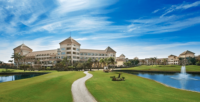 The exterior of the Hilton Pyramids Golf Resort outside of Cairo