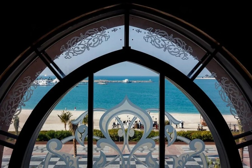 Looking out to the water through a window at the Emirates Palace Hotel