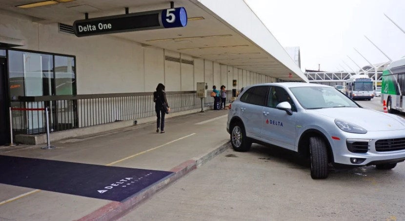 "Delta ONE access provides curb-side delivery in a Porsche Cayenne. (Meanwhile, a visit to Los Angeles in June provides overcast skies known as ""June Gloom."")"