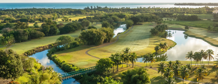 Enjoy spectacular ocean views as you play a round on one of two 18-hole championship golf courses at the Wyndham Grand Rio Mar in Puerto Rico.