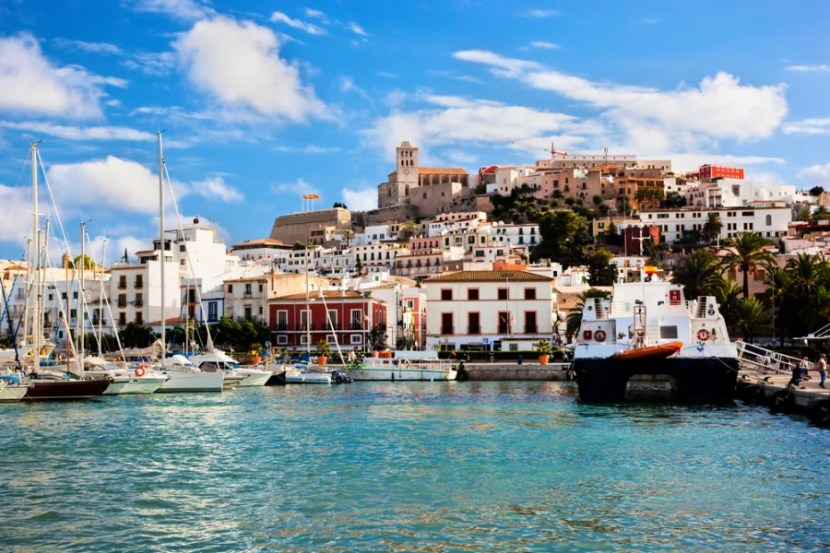Enjoy spending your vacation budget in Ibiza's old city of Eivissa — but be sure to use a credit card that doesn't charge foreign transaction fees. Photo courtesy of Shutterstock.
