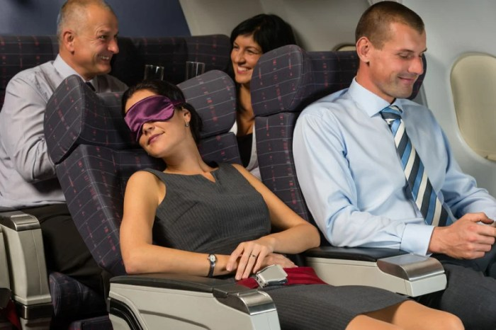 Which one of these four travelers will be the least jet lagged when landing in Europe? You got it, the one that's asleep! Photo courtesy of Shutterstock.