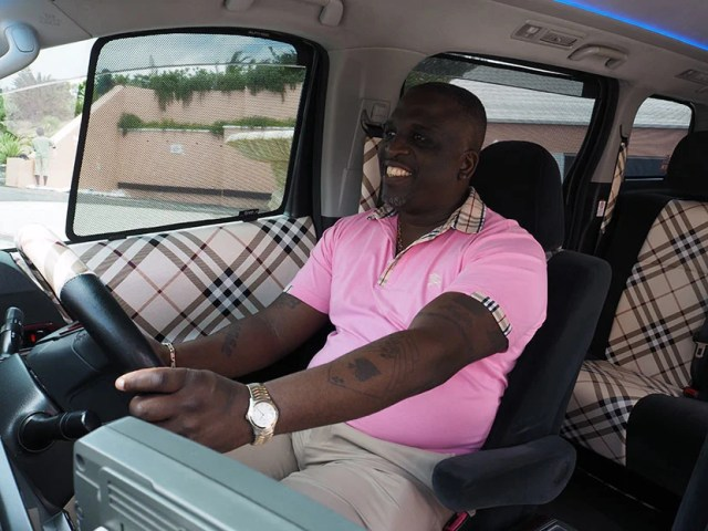 Driver Vaughn Joseph in his Burberry-ified cab.