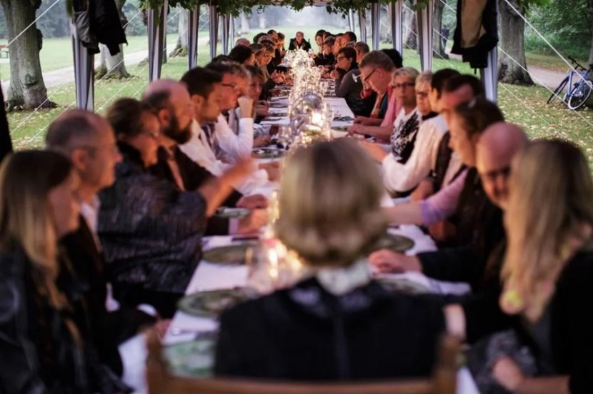 Pull up to a long table at a themed dinner during Copenhagen Cooking. Photo courtesy of Copenhagen Cooking.