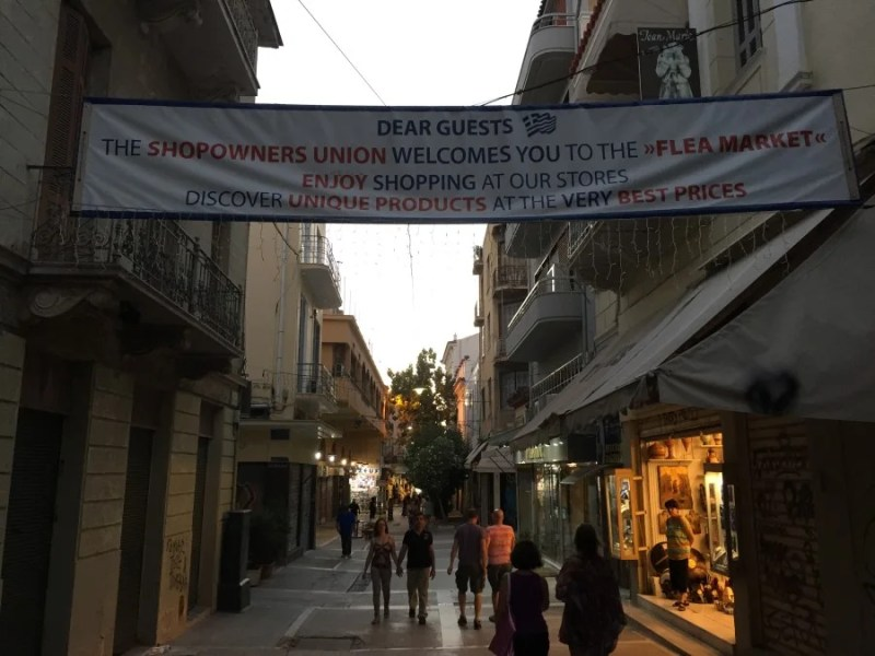 A banner welcoming shoppers to the flea market in Monastiraki.