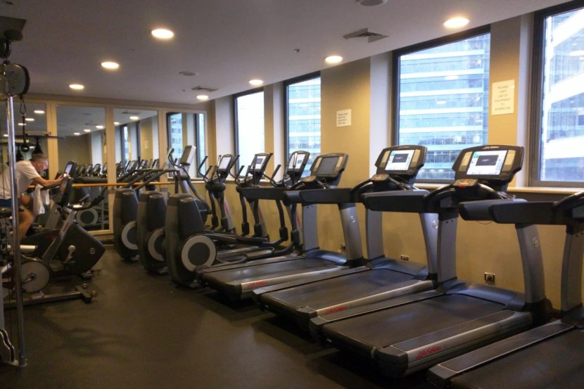 The gym on the 22nd floor has plenty of equipment, but it could benefit from a renovation.
