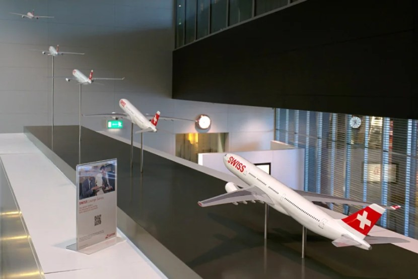 Swiss A330 models on display at the Terminal A lounge.