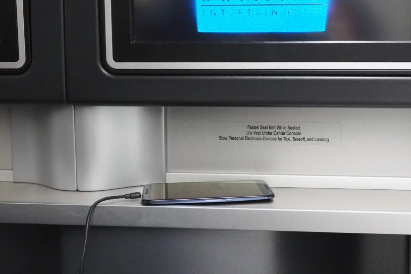 This ledge beneath the IFE screen is one of very few places to store items during the flight.