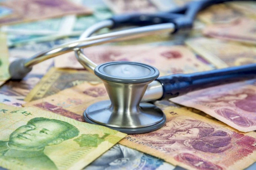 "Photo courtesy of <a href=""http://www.shutterstock.com/pic-144385828/stock-photo-money-from-china-and-a-stethoscope.html?src=haYwCP6UFAdoQI61R_Z9fw-1-131"">Shutterstock</a>"