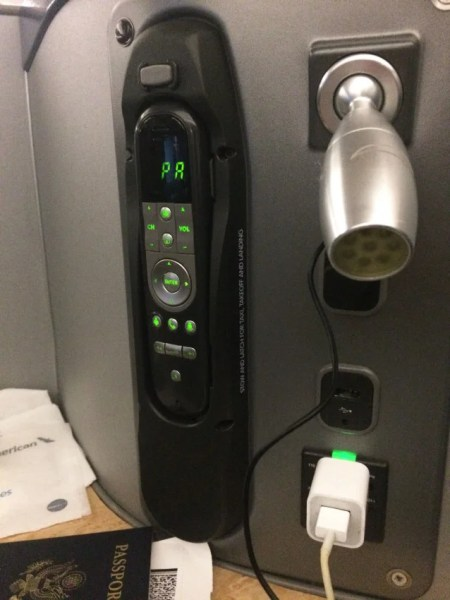 At each seat in US Airways' A330 business class, there's a TV remote, reading lamp, USB port and plug.