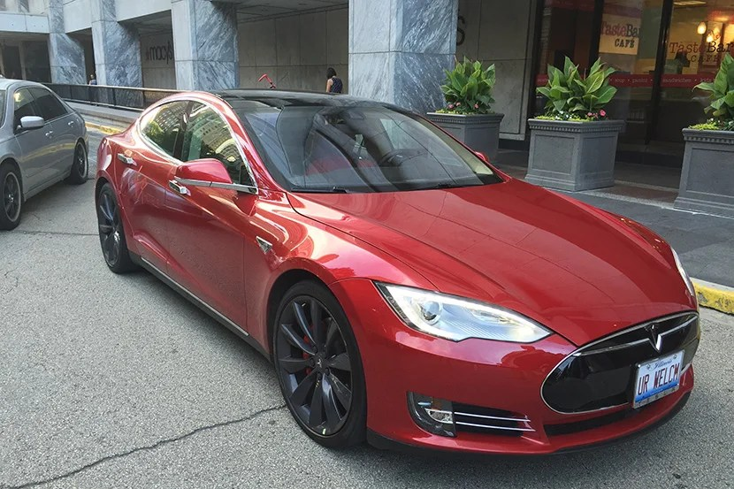 """My favorite part of the experience was the house car: a brand-new Tesla P85D with a license plate of """"UR WELCM""""."""