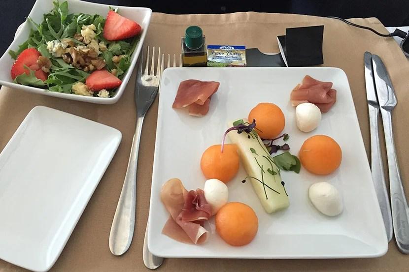 Plane food? My mozzarella, prosciutto and cantaloupe appetizer sure beats the salad in economy.