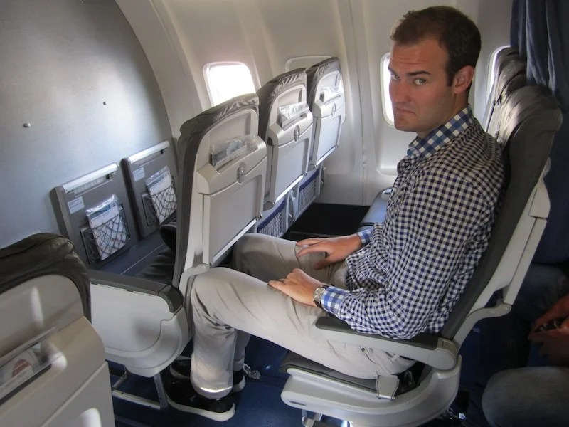 TPG doesn't look thrilled to be flying Lufthansa business.
