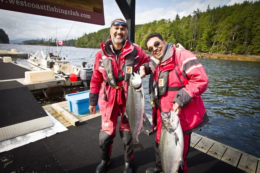 Ali Lila and Arif Jaffer showing off their first-ever catch of salmon from ocean waters.