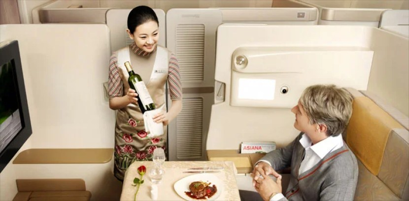 Asiana's first-class suites aren't flashy, but they feature privacy doors and fully flat beds.