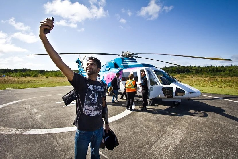 Khalil Jessa, an app developer from Vancouver, takes a selfie before boarding a chartered helicopter to The Outpost