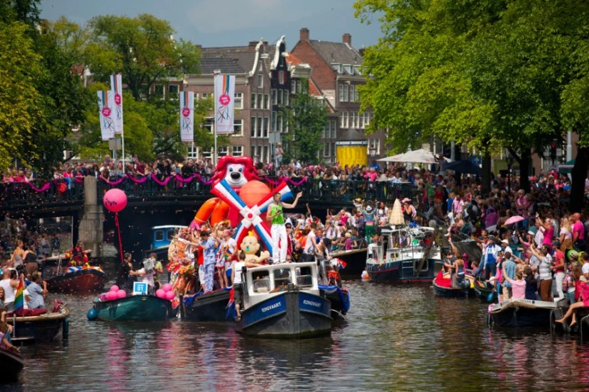 Amsterdam Pride is unique in that the parade takes place on the canals, so definitely pack a bathing suit! Photo courtesy of Shutterstock.