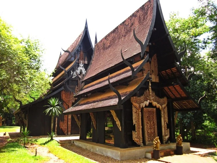The black house features several traditional Lanna buildings with an eerie vibe.