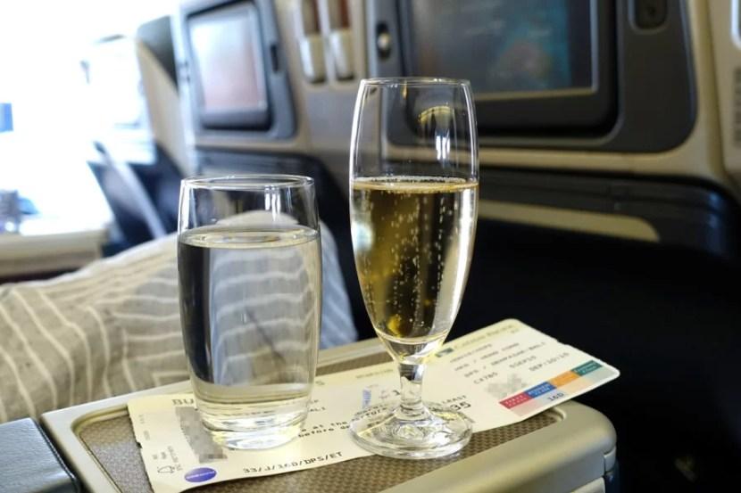 Flight attendants served Champagne before departure.