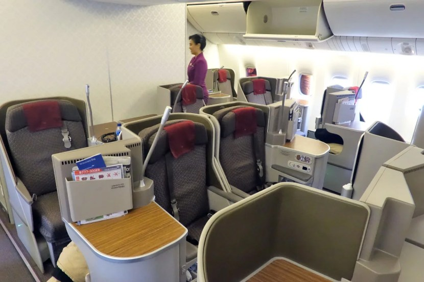 Business-class seats are in a staggered 1-2-1 configuration.