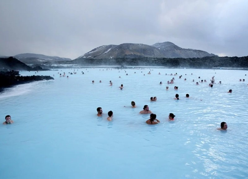 Visitors enjoying the healing waters and mineral-rich mud of the Blue Lagoon. Photo by David.