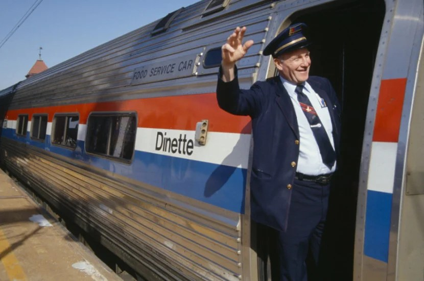 An Amtrak conductor waving goodbye to all of your accumulated points. Joseph Sohm / Shutterstock.com