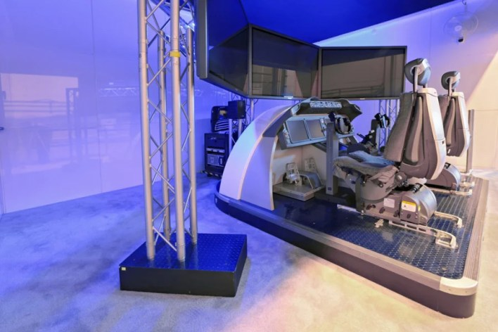 A large-scale flight simulator used to train pilots how to fly in real-time situations. Photo courtesy of Shutterstock.
