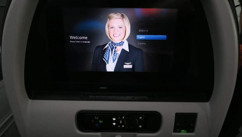American Airlines Dreamliner IFE screen, remote and power plug.