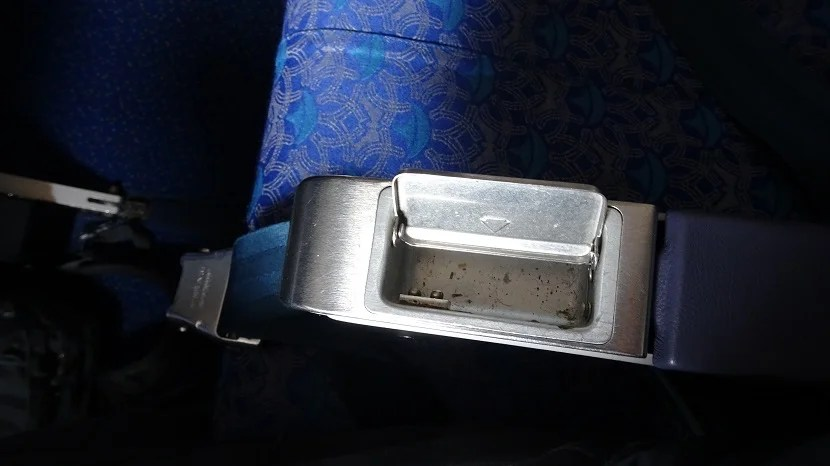 A working armrest ashtray -- A whiff of aviation nostalgia.