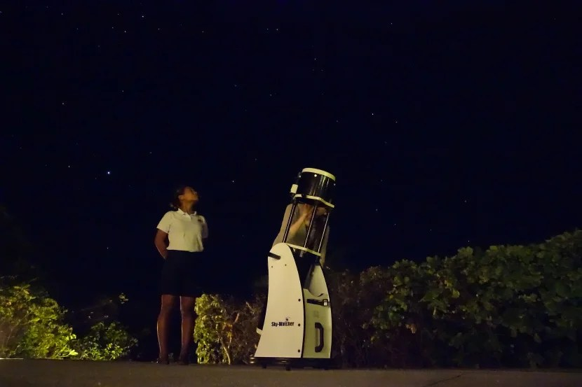 Checking out the night sky through Amanpulo's telescope.