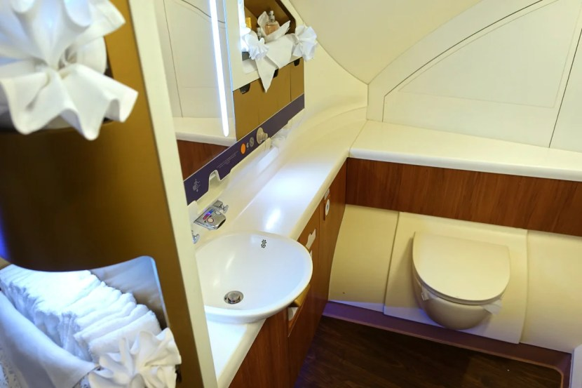 There's one large bathroom at the front left side of the cabin.