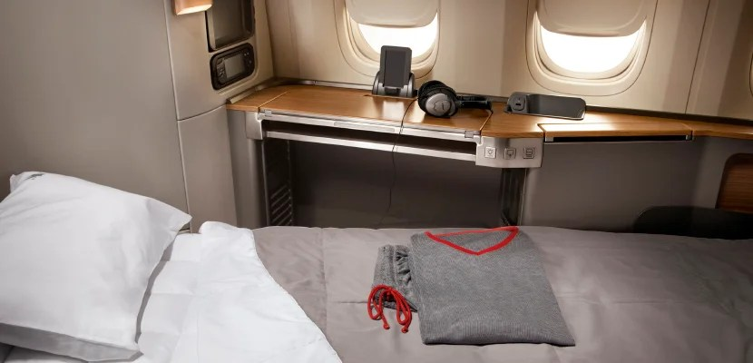 You'll earn actual miles flown plus a 50% bonus for flights in American first class.