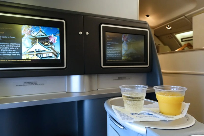 A flight attendant offered drinks prior to departure.